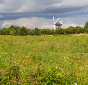 Wheatley windmill against stormy skies